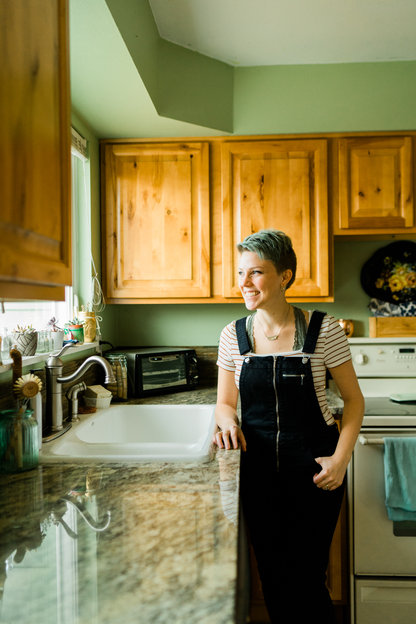 Katie standing in her zero waste kitchen