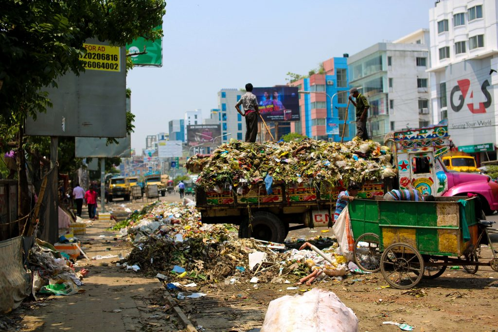 piles of garbage dumped in streets of third world country