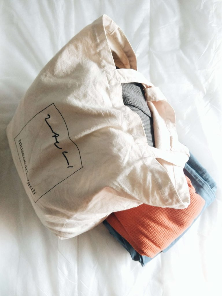 reusable bags with clothes inside