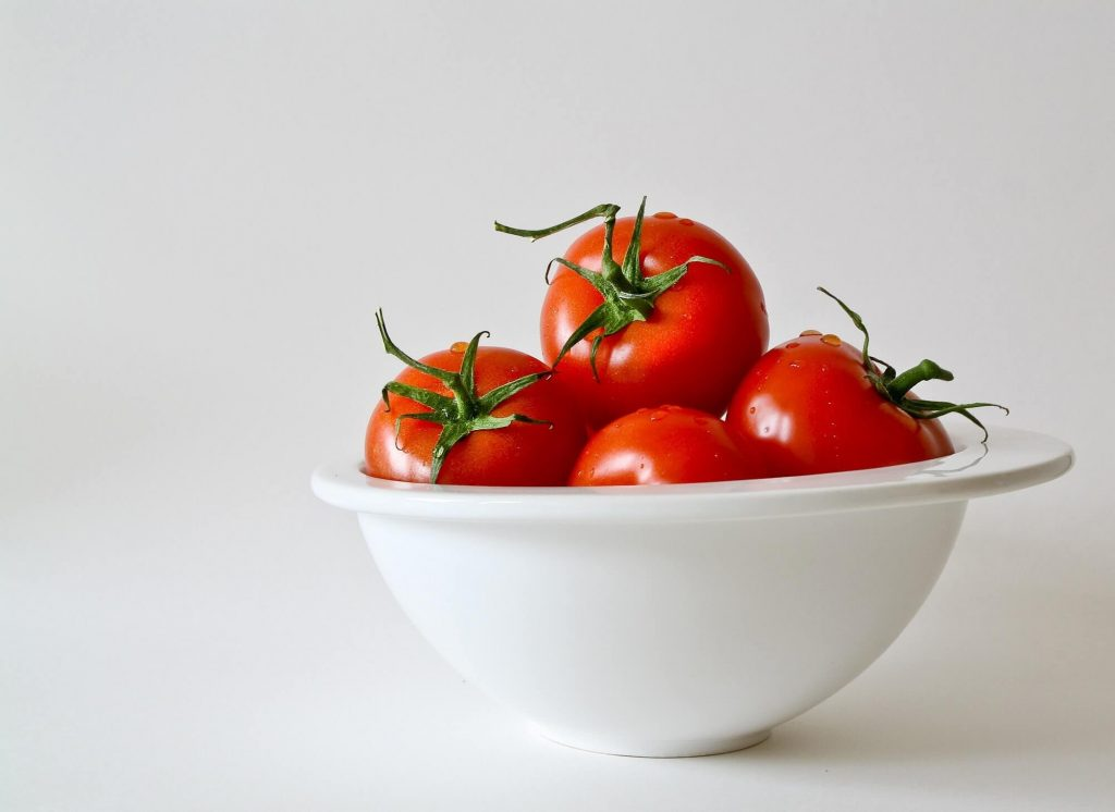 tomatoes in bowl on counter