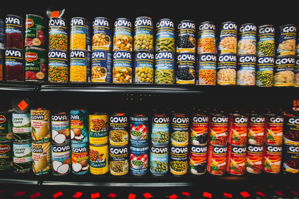 aluminum cans of food on shelves which is a more sustainable material when recycled for a zero waste shopping trip
