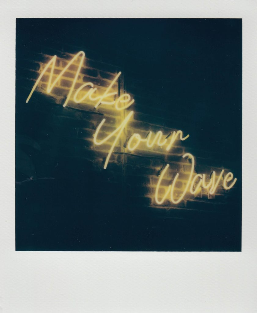 """neon sign that says """"make your wave"""""""