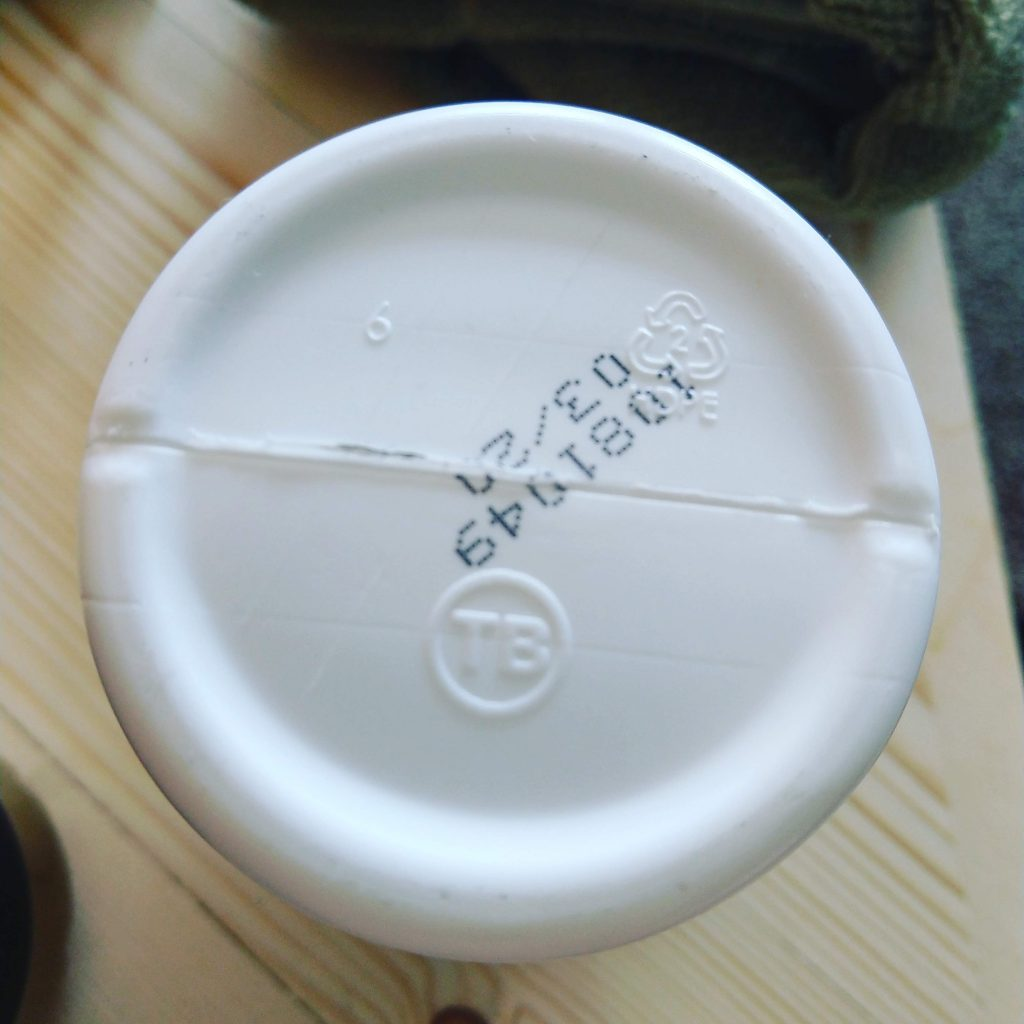 photo of plastic bottle with number 2 inside recycling symbol of arrows