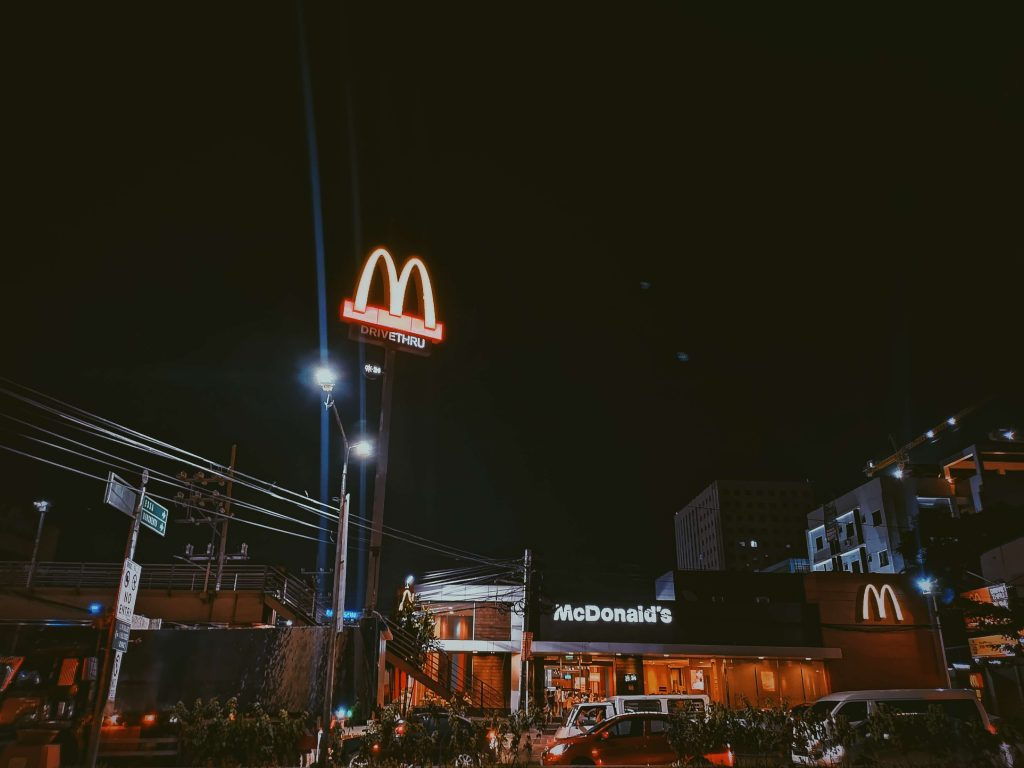 McDonalds on a dark city street representing food deserts being targeted by fast-food