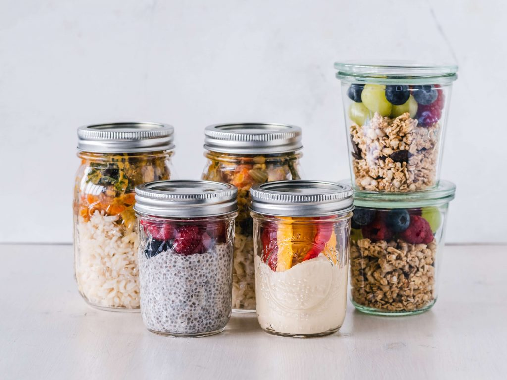mason jars with prepared snacks inside on counter