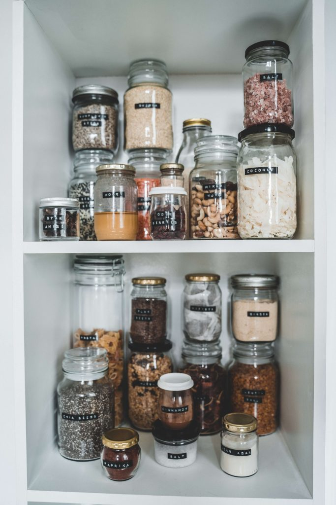 open cupboards to look for ingredients in pantry for meal planning