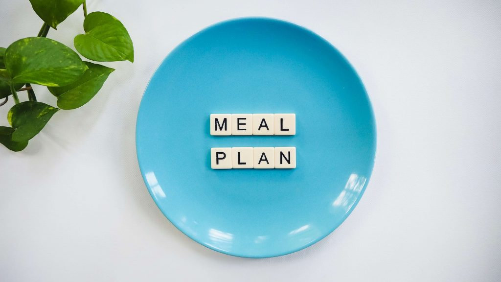 "blue plate with ""meal plan"" spelled out on letter tiles"