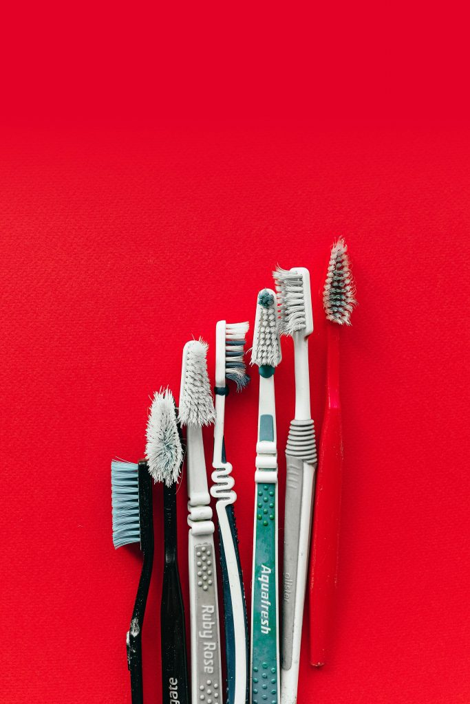 dirty plastic toothbrushes, dental care products