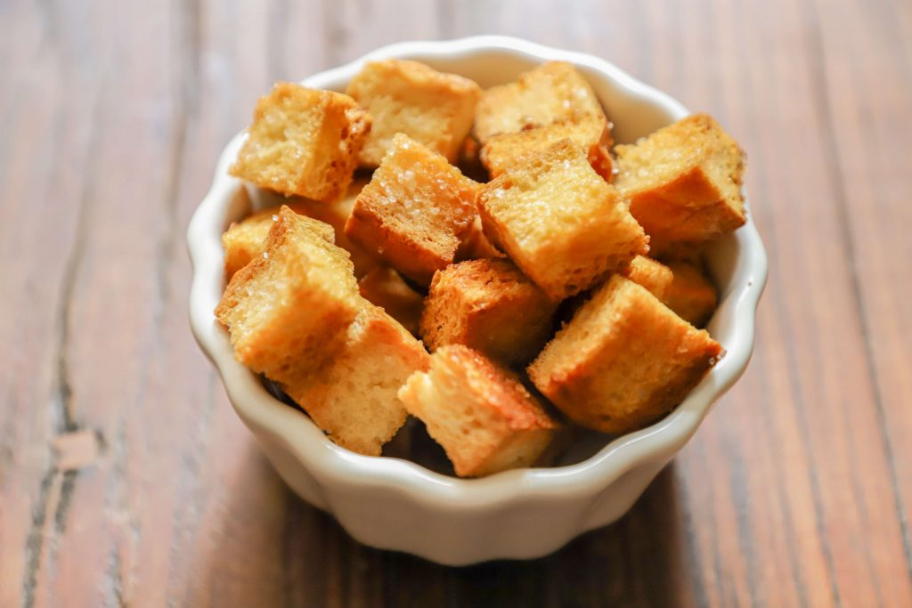bowl of croutons on table