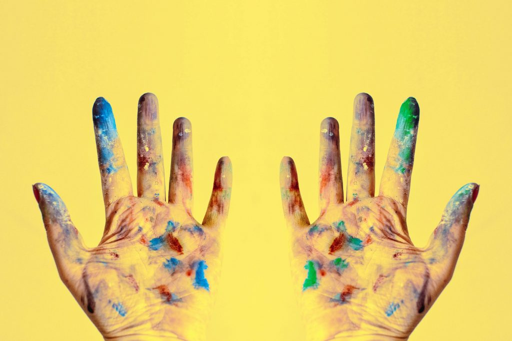 hands covered in color from dye