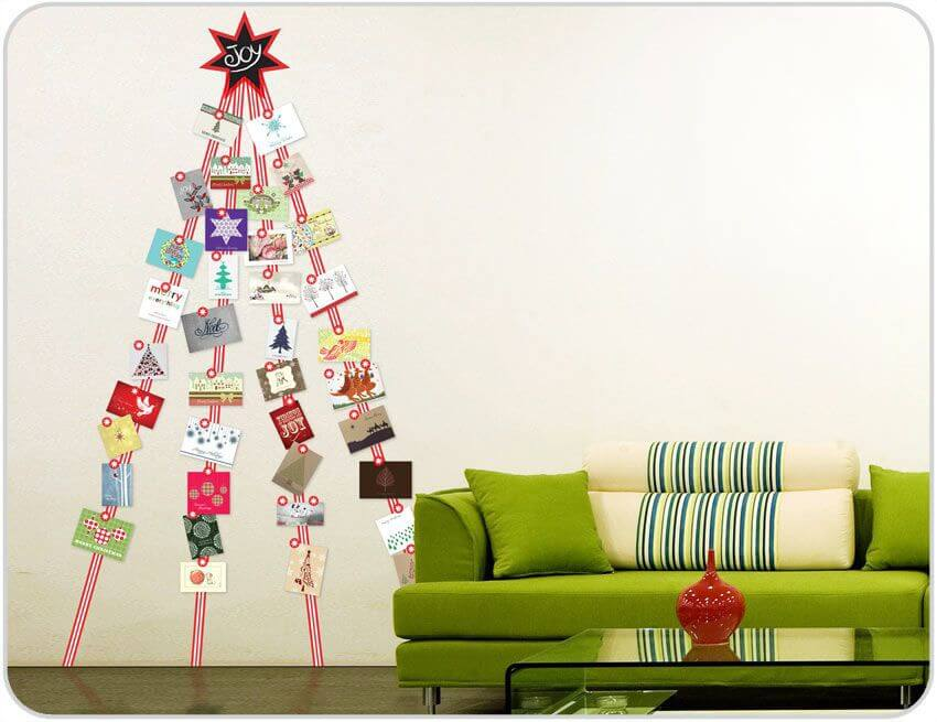 living room decorated with holiday cards hung on the wall in the shape of a tree