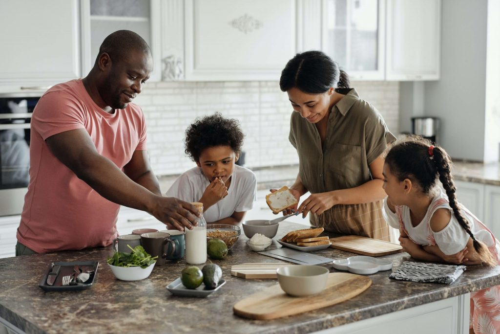 family making food together in kitchen