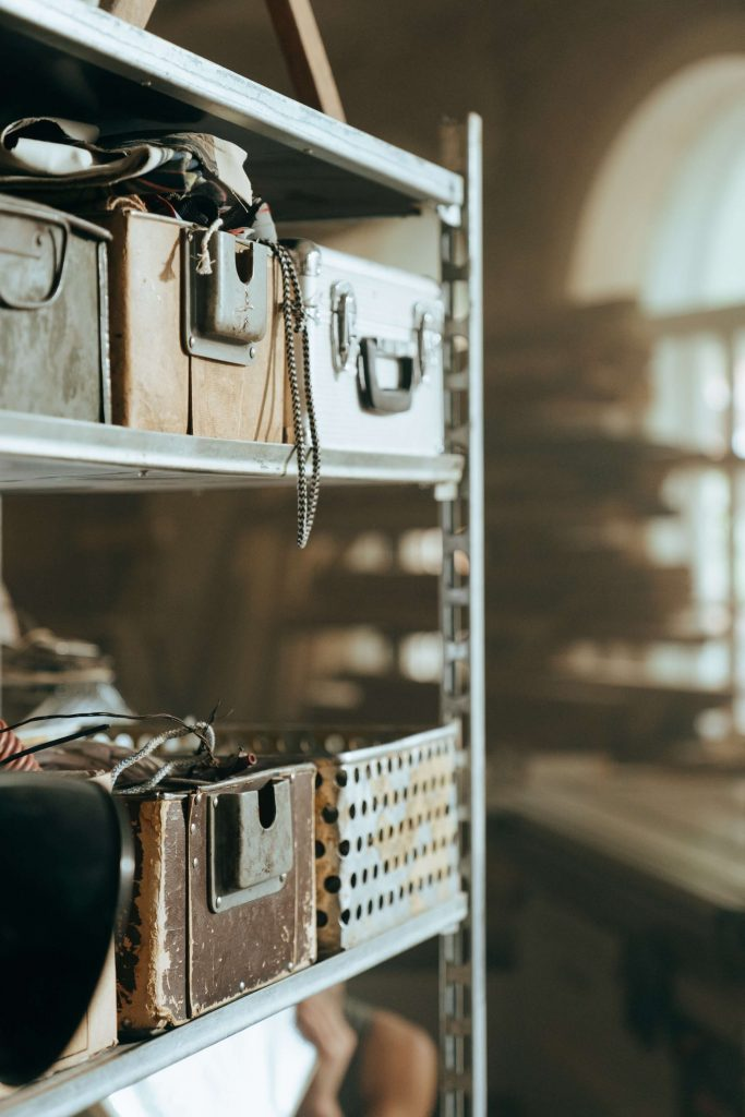 decorative items in old briefcases on thrift shop shelves