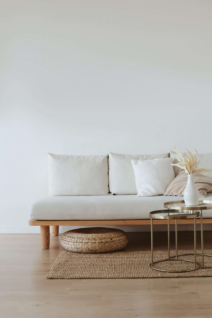 space of minimalism: white couch with simple decor