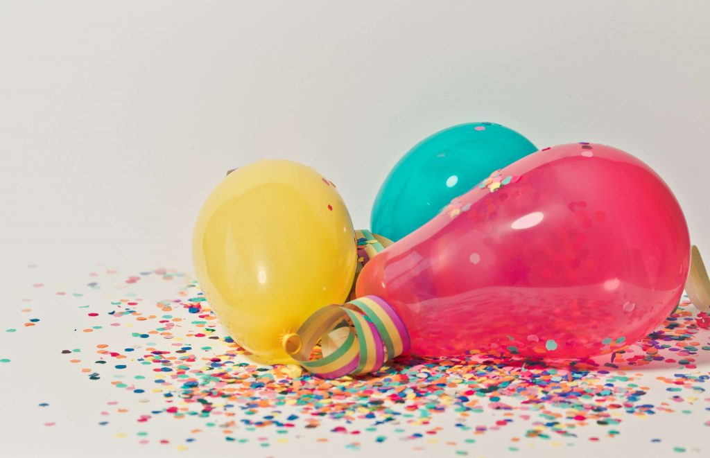 balloons surrounded by confetti